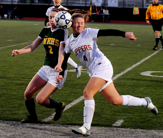 JIM VAIKNORAS/Staff photo Newburport's Cricket Good collides with North Reading's Juliette Nadeau at the Manning Field in Lynn Saturday night.