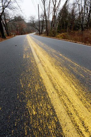 BRYAN EATON/Staff photo. A paint spill stretches 7/10 of a mile along Bachelor Street in West Newbury. The spill – which occurred when a truck owned by RoadSafe pavement marking company was exiting the town after performing work on Main Street splattered yellow the paint along Bachelor Street from Meeting House Hill Road to Middle Street.