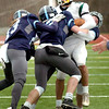 BRYAN EATON/Staff photo. Triton defenders take down Pentucket's Robert Porter.