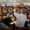 JIM VAIKNORAS/Staff photo A large crowd fills a tent as John McInnis auctions off Items at 26 Tyng St Newburyport in Friday morning.
