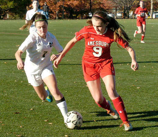 BRYAN EATON/Staff photo. Amesbury player Michaela Halloran moves the ball with a Matignon player moving in.