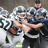BRYAN EATON/Staff photo. Triton defenders grab Pentucket's Liam Sheehy.