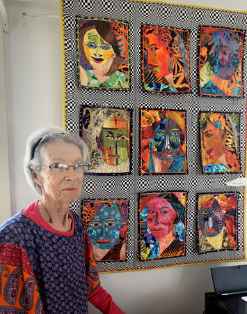 """BRYAN EATON/Staff photo. Merrimac resident Brenda Paterson is having a showing of her quilts at the town's library. She's in front of her work """"Faces."""""""