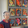 "BRYAN EATON/Staff photo. Merrimac resident Brenda Paterson is having a showing of her quilts at the town's library. She's in front of her work ""Faces."""