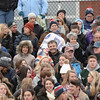 BRYAN EATON/Staff photo. Football fans bundled up for the cold weather in Byfield.
