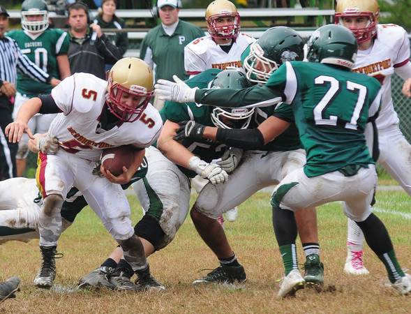JIM VAIKNORAS/Staff photo <br /> Newburyport's James Gallo is tackled by  Pentucket players during their game at Pentucket Saturday.