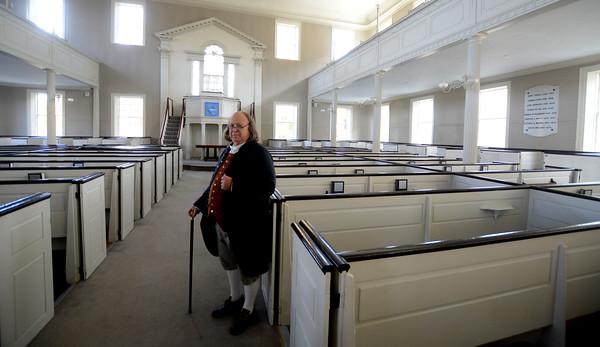 JIM VAIKNORAS/Staff photo Ben Frankin visits the Unitarian Universalist Church in Newburyport.