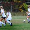 BRYAN EATON/Staff Photo. Newburyport girls soccer team run with the ball in practice.