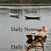 Amesbury-Dory boats rest idle outside of Lowell's Boat Shop on Friday afternoon. Brett Languirand/Staff photo