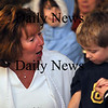 Salisbury - Nurse Cathy Vichill congratulates one of the many children who had reservations to receive the H1N1 vaccine at Salisbury Fire Station on Wednesday evening.  Brett Languirand/Staff photo