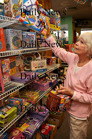 Amesbury - Joyce Reed, the owner of Fiddlesticks, straightens out the store on Friday afternoon.  Brett Languirand/staff photo