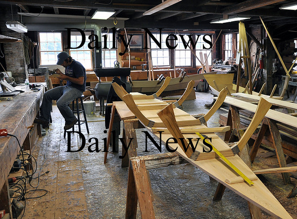 Amesbury-Graham McKay works on a dory boat inside of Lowell's Boat Shop on Friday afternoon.  Brett Languirand/Staff photo