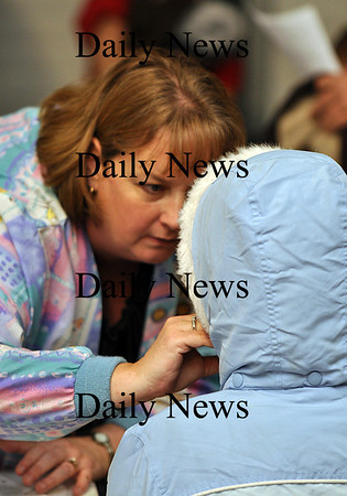 Salisbury - Nurse Melinda Gibons gives the H1N1 nasal mist to one of the many people with reservations to receive the vaccine at Salisbury Fire Station on Wednesday evening.  Brett Languirand/Staff photo