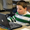 Amesbury-Sean O'Neill works diligently on a laptop at the Cashman Elementary School on Friday afternoon. Brett Languirand/Staff Photo