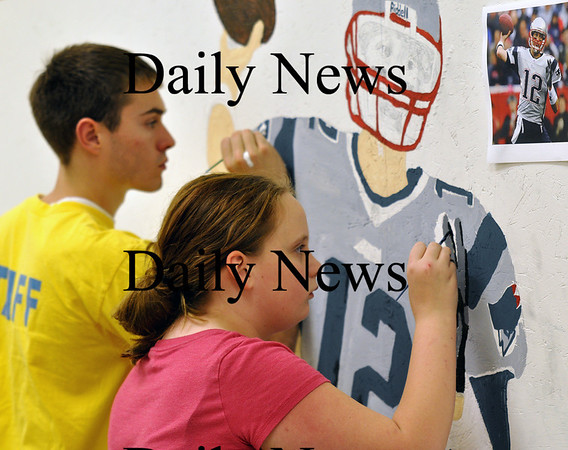 Salisbury - Staff member Peter Krajeski and Chyenne Adams paint in Tom Brady's jersey in a sports themed wall mural at the Boys and Girls club during a rainy Monday afternoon.  Brett Languirand/Staff photo