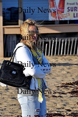 Salisbury-Samantha Levinson of Amesbury braves strong winds to visit Salisbury Beach on Wednesday afternoon.  Brett Languirand/Staff photo
