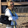 Salisbury-Samantha Levinson of Amesbury braves strong winds to visit Salisbury Beach on Wednesday afternoon.  Brett Languirand/Staff photo