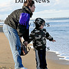 Salisbury-Kari Boverhof and her son Justin stop at Salisbury Beach while traveling from New Aygo, Michigan to Burlington, Vermont on Wednesday afternoon.  Brett Languirand/Staff photo
