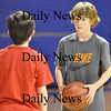 Salisbury - Wyatt Boyce stares down his opponent Dylan Copeland during a mini basketball tournament at the Boys and Girls club on Wednesday Afternoon.  Wyatt led his team in scoring in game 3 of the tournament.  Brett Languirand/Staff photo