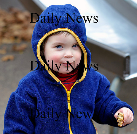 Newburyport - Charles (last name not given) enjoys a chocolate chip cookie at the Tot Lot on Friday afternoon.  Brett Languirand/Staff photo