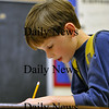 Salisbury - Roger Korpics draws an abstract masterpeice before leaving for the day at the Boys and Girls Club.