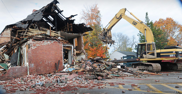 Amesbury: A front-end loader started the demolition of the Amesbury Town Hall annex on Tuesday morning. City offices that had occupied the building have been moved to the Costello Transportation Center. Bryan Eaton/Staff Photo