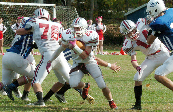Georgetown: Amesbury's Ben Cullen finds a hole in the Georgetown defense on Saturday. Bryan Eaton/Staff Photo