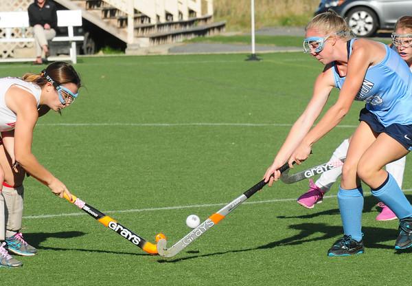Amesbury: Amesbury's Sarah Donohue tries to get the ball past Triton's Jessica Savage. Bryan Eaton/Staff Photo