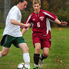West Newbury: Pentucket's Brendan Sullivan moves past the Clippers' Ryan Furlong. Bryan Eaton/Staff Photo