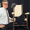 "Amesbury: Auctioneer Dan Meader with ""rocker II"" that President John F. Kennedy used on Cape Cod along with a cashmere jacket made for him in 1961 and a fedora hat worn by the slain president. Bryan Eaton/Staff Photo"