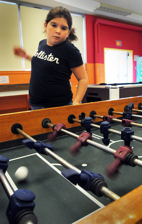 Salisbury: Jamey Caron, 9, throws some strong wrist action while playing a game of foosball during free time at the Boys and Girls Club in Salisbury on Thursday afternoon. Bryan Eaton/Staff Photo