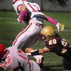 Newburyport: Newburyport's Ethan Northey grabs on to Masco's Corey Tines. Bryan Eaton/Staff Photo