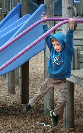 Amesbury: Ben Richard, 7, hangs around literally at the playground at Amesbury Elementary School. He was in the Amesbury Recreation Department's Afterschool Program playing with friends after snack time. Bryan Eaton/Staff Photo