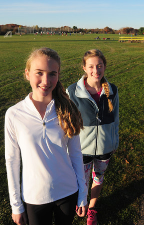 Byfield: Triton cross country runner Maddie Quigley, left, with teammate and mentor Liz Willmonton. Bryan Eaton/Staff Photo
