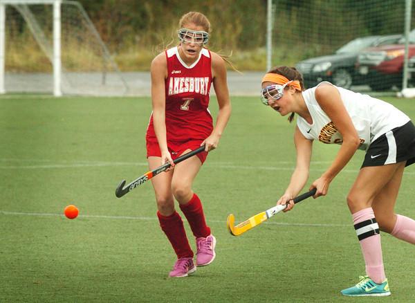 Amesbury: Newburyport's Molly Stanton shoots the ball past Amesbury's Kate Gagnon. Bryan Eaton/Staff Photo