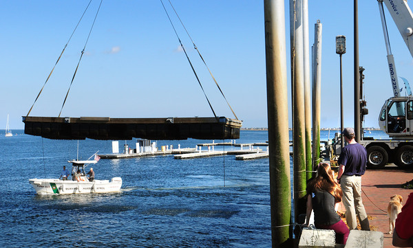 Newburyport: Though the temperature yesterday was around 73 degrees, Newburyport city docks were taken out of the Merrimack River at Cashman Park and here near the harbormasters shack, as the boating season begins to wind down. Bryan Eaton/Staff Photo