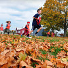 Newburyport: Youngsters from the Newburyport Montessori School play a game of Human Monopoly amongst the leaves behind the Custom House Maritim Museum on Tuesday during the warm weather. The weather is to cool down as a front comes possibly bringing some rain. Bryan Eaton/Staff Photo
