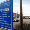 Newburyport: A sign greeting drivers into the Newburyport Waterfront Trust parking lot states that resident parking permits are not valid in this downtown lot as they are in the Green Street lot. Bryan Eaton/Staff Photo