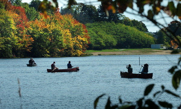 Amesbury: People took their canoes out onto Lake Gardner in Amesbury on Wednesday and got to catch some of the trees turning color. Bryan Eaton/Staff Photo