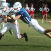 Georgetown: Georgetown's Daniel Lambert corrals Amesbury's Ryan Foley. Bryan Eaton/Staff Photo