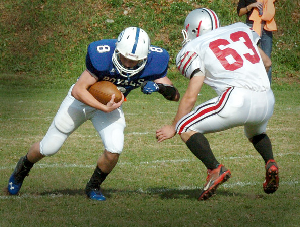 Georgetown: Amesbury's 63 is ready to tackle Georgetown's Cooper Martens after catching a pass. Bryan Eaton/Staff Photo