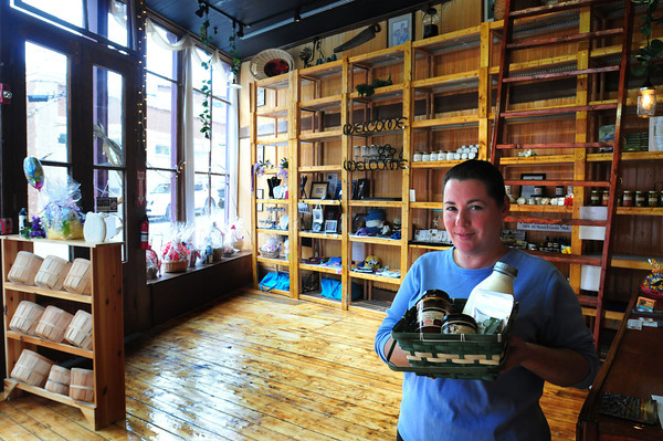 Amesbury: Manager of the soon-to-be-opened Carriagetown Organic Market and General Store Shirley Theodore shows some of the items they'll carry including milk from a farm in Dracut. The shop which also sells some gifts is located next to Crave Restaurant. Bryan Eaton/Staff Photo