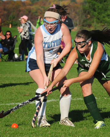 Byfield: Pentucket's Erin Mikson tries to get the ball from Triton's Emily Hirtle. Bryan Eaton/Staff Photo