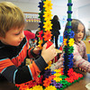"""Amesbury: Casey Benson, left, and Aidan Allen, both 5, work on, according to Casey, a """"defender ray"""" at Amesbury Elementary School on Wednesday. The two were in free choice time in Susan Gonthier's kindergarten class. Bryan Eaton/Staff Photo"""