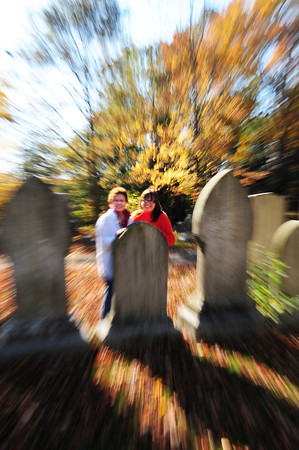 Newburyport: Jane Wild, left, and Colleen Turner Secino pose at the Caleb Cushing family's gravestones at Oak Hill Cemetery. The two are co-chairman of the Newbury Historical Society's fundraising Halloween Haunting on Friday night. Bryan Eaton/Staff Photo