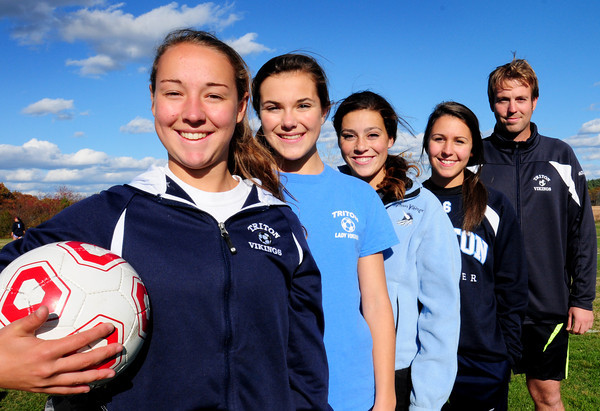 Byfield: From left, Triton girls soccer senior co-captains Casey Ross and Madison Williams with fellow seniors Shannon Dube, Rachel Hall and coach Mike Weisburg. Bryan Eaton/Staff Photo