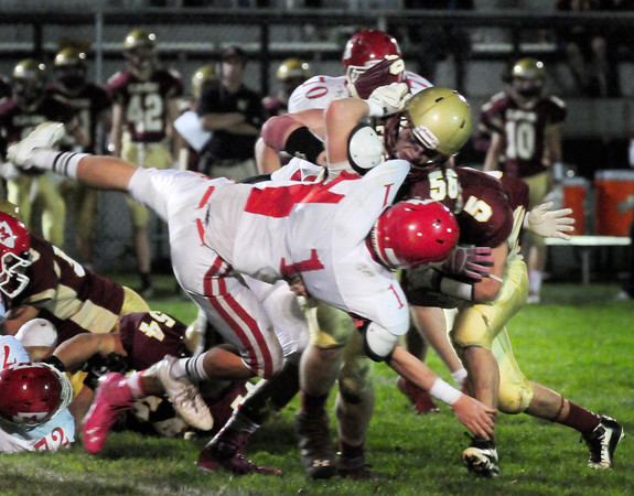 Newburyport: Newburyport's Dillon Guthro throws Masconomet's Austin Cashin to make way for Clipper fullback Trevor Bradbury. Bryan Eaton/Staff Photo
