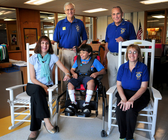 Newburyport: The Newburyport Lions Club donated these two rocking chairs to the Special Education Department at the Nock Middle School. Clockwise, from front center, is Caleb with occupational therapist Eric Rich, and Lions members Bob LaFrance, Bob Colomycki and Kathy Heywood. Bryan Eaton/Staff Photo