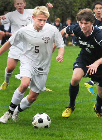 Newburyport: Newburyport's Adam Traxler moves the ball past a Hamilton-Wenham player at Cherry Hill Field. Bryan Eaton/Staff Photo