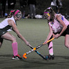 Amesbury: Pentucket's #4 and Newburyport's Ashley Hodge, right, clash for the ball last night at the Amesbury Sports Park. Bryan Eaton/Staff Photo